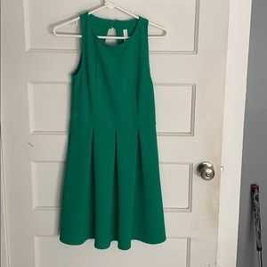 A line green dress with cut out back detail